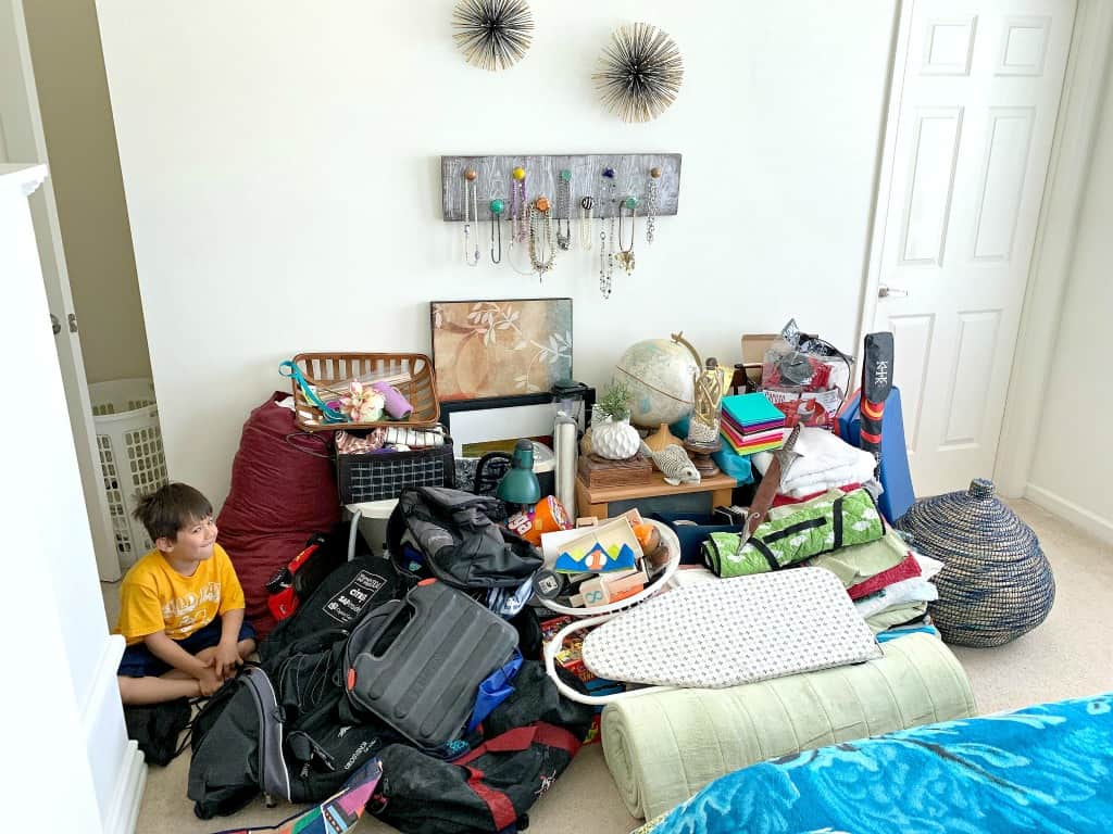 Picture of extreme decluttering a bedroom full of stuff.