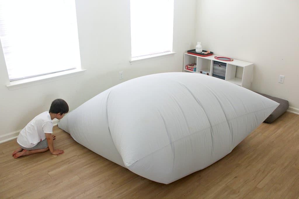 A boy making a DIY air fort
