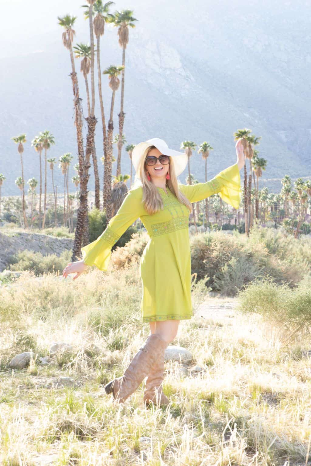A niche blogger in a yellow dress in the desert