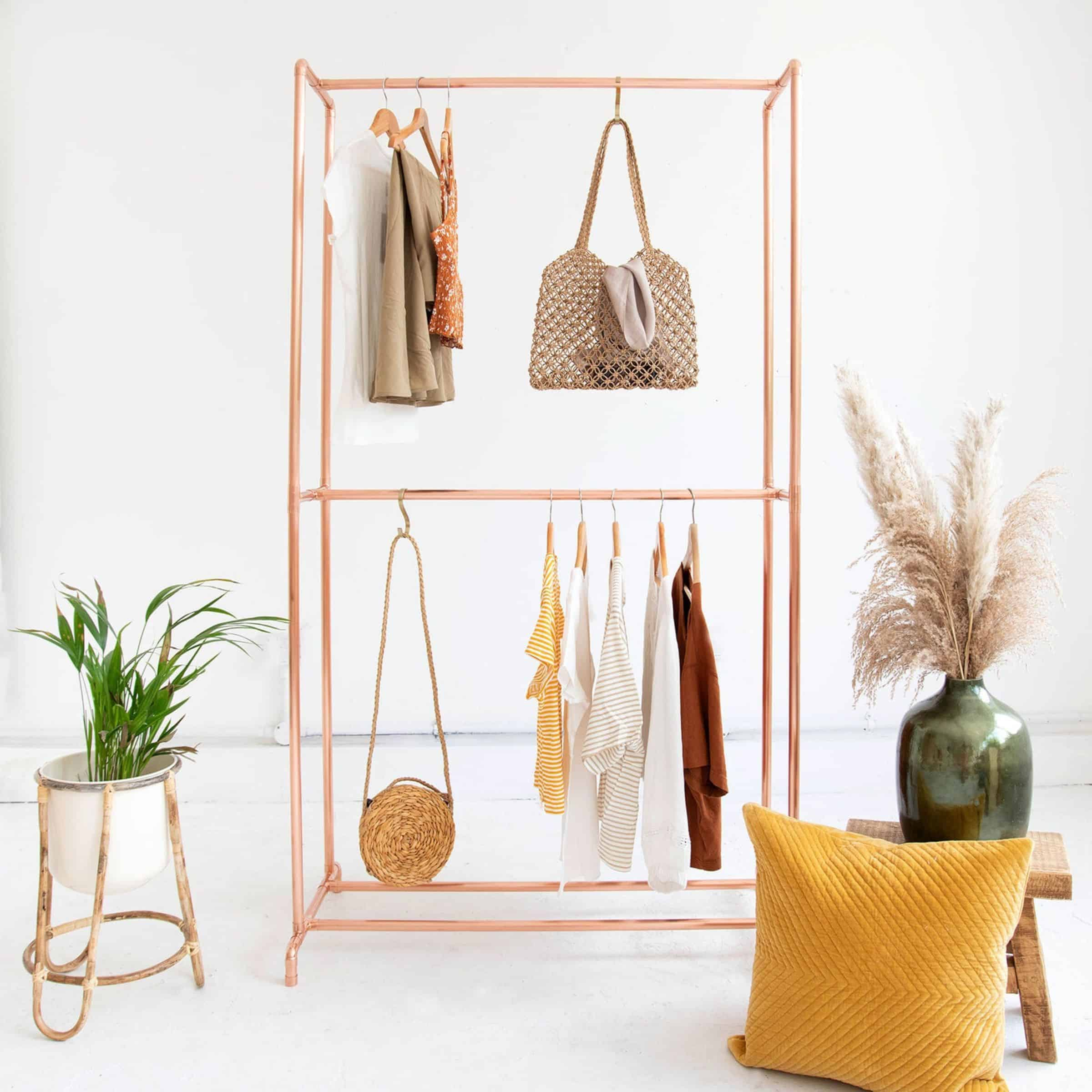 A minimalist double copper capsule wardrobe rack