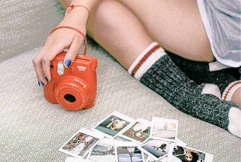 A girl using photos and other vision board supplies