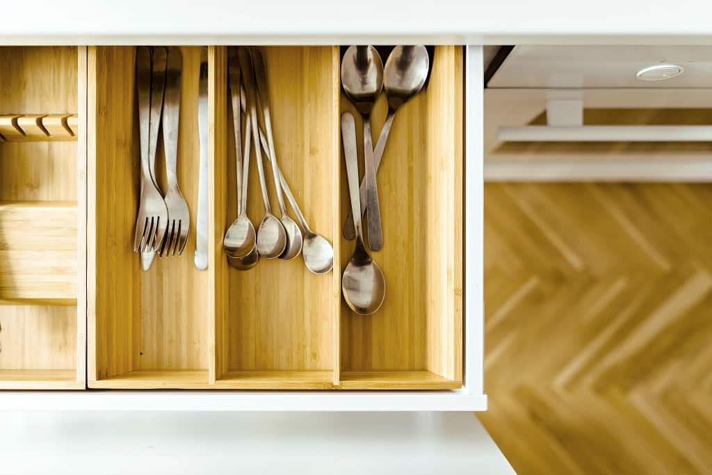 A minimalist drawer with beautifully organized utensils