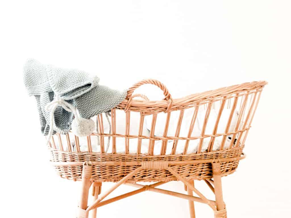A rattan crib from a minimalist baby registry