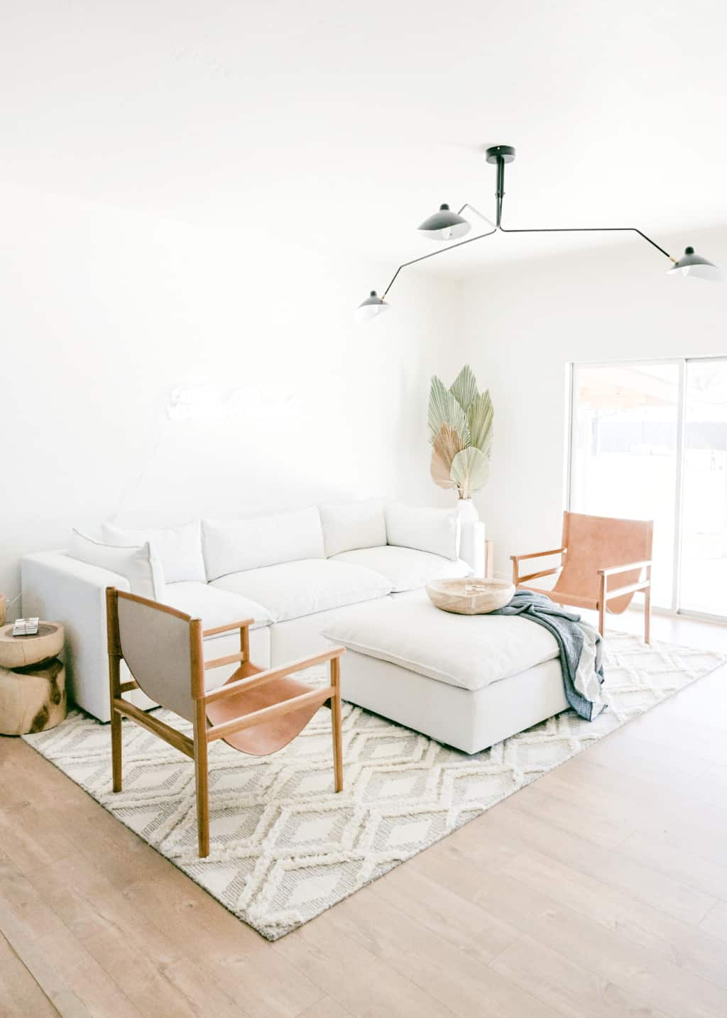 A cozy white minimalist living room with modern decor