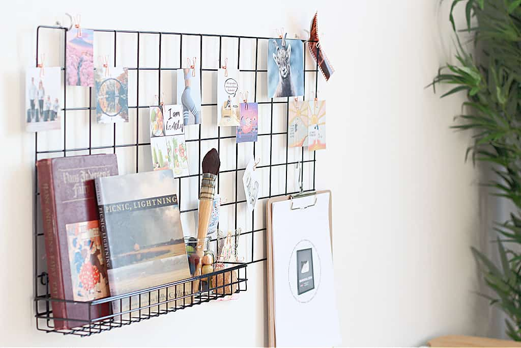 A wall grid dream board with images & quotes