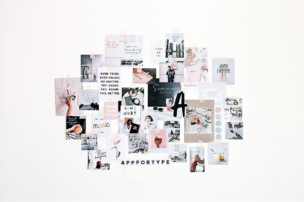 Vision board images taped to a wall