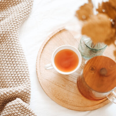 A wooden tray with tea for a daily be intentional practice