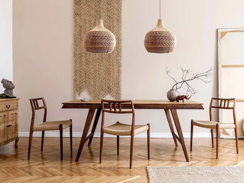 A dining room in a minimalist apartment with modern chairs and table.