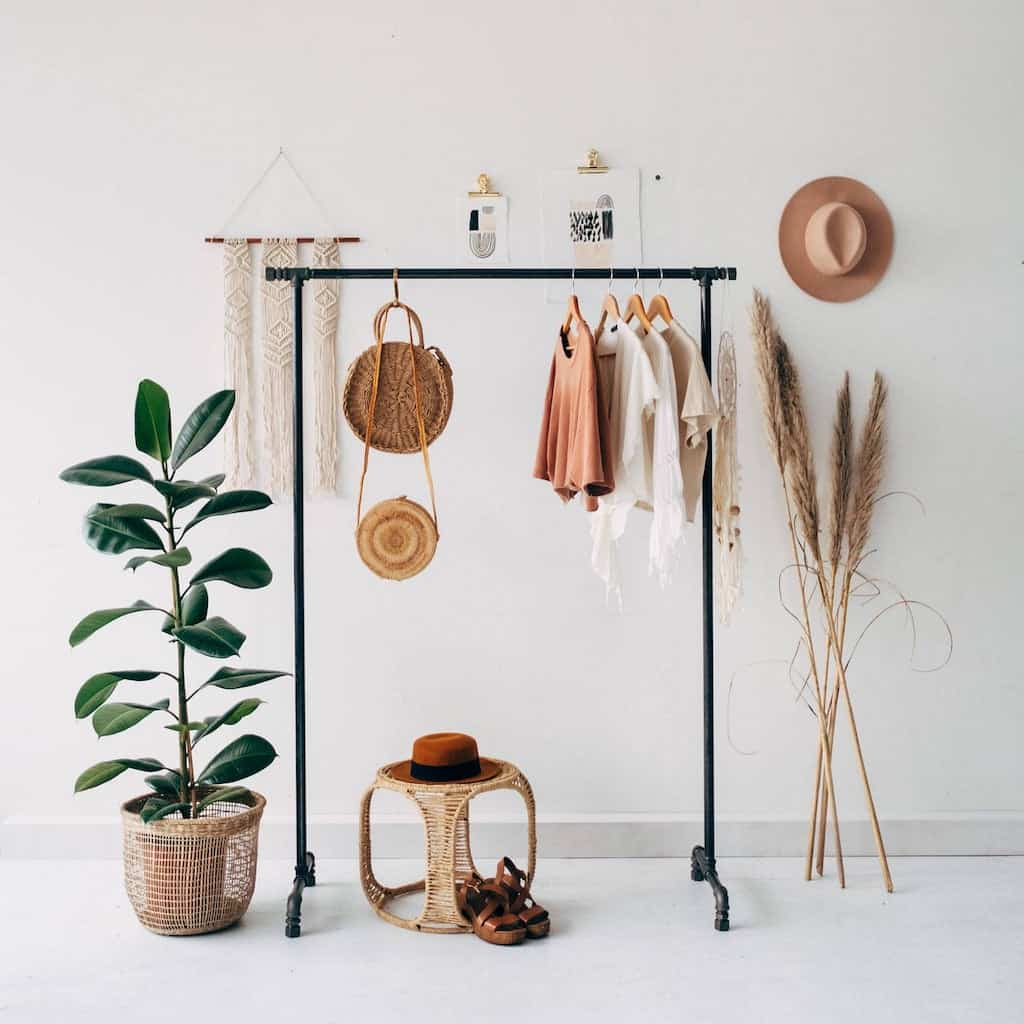 A capsule wardrobe in a minimalist apartment bedroom