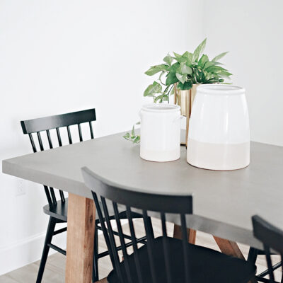 A minimalist table with black chairs